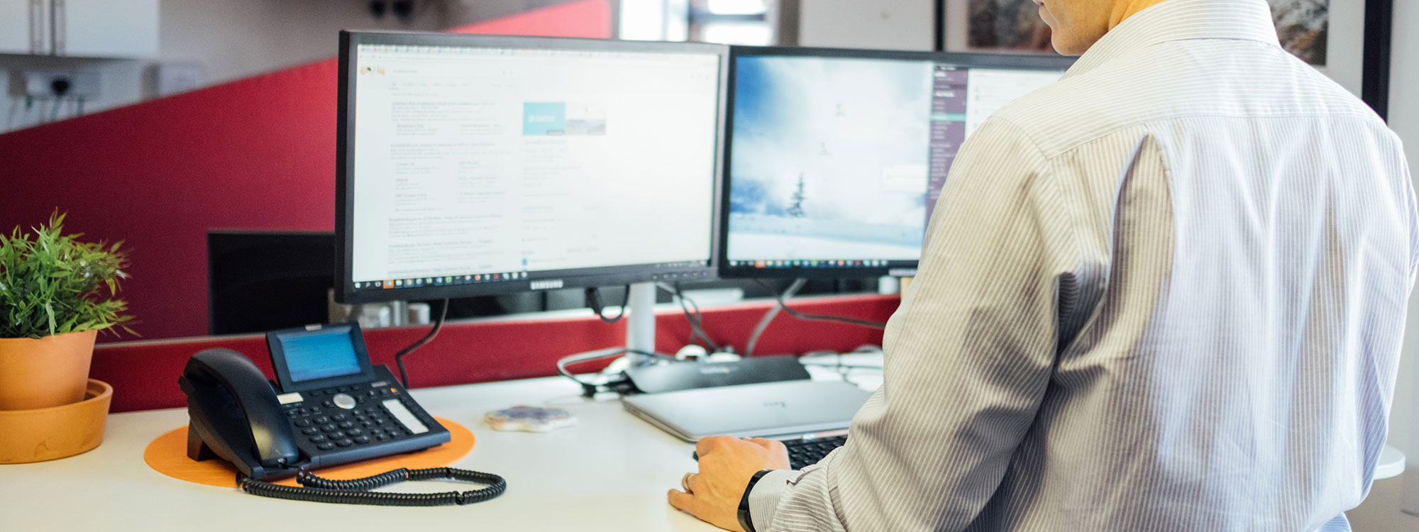 image showing man with 2 computer screens