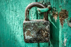 padlock on green door